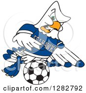 Clipart Of A Tough Seahawk Sports School Mascot Character Playing Soccer Royalty Free Vector Illustration