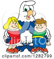 Clipart Of A Happy Seahawk School Mascot Character Posing With Students Royalty Free Vector Illustration