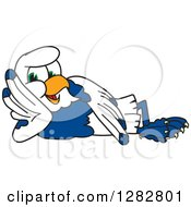 Clipart Of A Happy Seahawk School Mascot Character Resting On His Side Royalty Free Vector Illustration