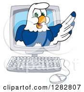 Clipart Of A Happy Seahawk School Mascot Character Emerging From A Desktop Computer Screen Royalty Free Vector Illustration