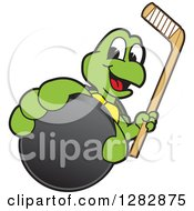 Clipart Of A Happy Turtle School Sports Mascot Character Holding Out An Ice Hockey Puck And Stick Royalty Free Vector Illustration