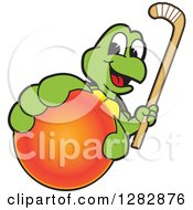 Clipart Of A Happy Turtle School Sports Mascot Character Holding Out A Field Hockey Ball And Stick Royalty Free Vector Illustration by Toons4Biz