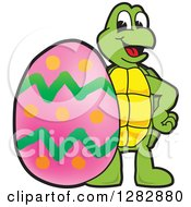 Clipart Of A Happy Turtle School Mascot Character With A Giant Easter Egg Royalty Free Vector Illustration by Toons4Biz