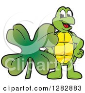 Clipart Of A Happy Turtle School Mascot Character With A St Patricks Day Four Leaf Clover Shamrock Royalty Free Vector Illustration