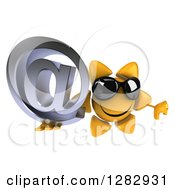 Clipart Of A 3d Sun Character Wearing Sunglasses Holding Up An Email Arobase At Symbol And Thumb Down Royalty Free Illustration