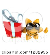 Clipart Of A 3d Sun Character Wearing Sunglasses And Holding Up Thumb And A Gift Royalty Free Illustration