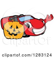 Happy Red Convertible Car Mascot Character Waving By A Halloween Jackolantern Pumpkin