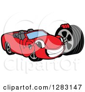 Happy Red Convertible Car Mascot Character Gesturing Ok And Holding A Tire