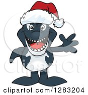 Clipart Of A Friendly Waving Orca Wearing A Christmas Santa Hat Royalty Free Vector Illustration
