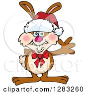 Friendly Waving Brown Easter Bunny Rabbit Wearing A Christmas Santa Hat