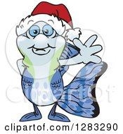 Clipart Of A Friendly Waving Guppy Fish Wearing A Christmas Santa Hat Royalty Free Vector Illustration by Dennis Holmes Designs