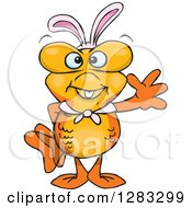 Clipart Of A Friendly Waving Goldfish Wearing Easter Bunny Ears Royalty Free Vector Illustration by Dennis Holmes Designs