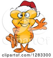 Friendly Waving Goldfish Wearing A Christmas Santa Hat