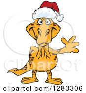 Clipart Of A Friendly Waving Goanna Lizard Wearing A Christmas Santa Hat Royalty Free Vector Illustration by Dennis Holmes Designs