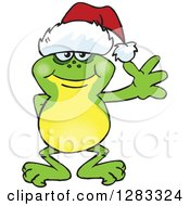 Clipart Of A Friendly Waving Frog Wearing A Christmas Santa Hat Royalty Free Vector Illustration by Dennis Holmes Designs