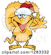 Clipart Of A Friendly Waving Frill Necked Lizard Wearing A Christmas Santa Hat Royalty Free Vector Illustration