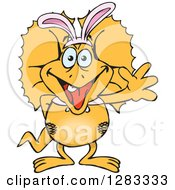 Clipart Of A Friendly Waving Frill Necked Lizard Wearing Easter Bunny Ears Royalty Free Vector Illustration by Dennis Holmes Designs