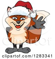 Clipart Of A Friendly Waving Fox Wearing A Christmas Santa Hat Royalty Free Vector Illustration by Dennis Holmes Designs
