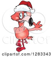 Clipart Of A Friendly Waving Pink Flamingo Wearing A Christmas Santa Hat Royalty Free Vector Illustration by Dennis Holmes Designs