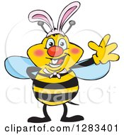 Clipart Of A Friendly Waving Bee Wearing Easter Bunny Ears Royalty Free Vector Illustration