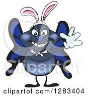 Clipart Of A Friendly Waving Blue Butterfly Wearing Easter Bunny Ears Royalty Free Vector Illustration