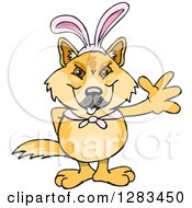 Clipart Of A Friendly Waving Dingo Wearing Easter Bunny Ears Royalty Free Vector Illustration by Dennis Holmes Designs