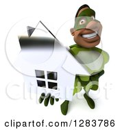 Clipart Of A 3d Male Black Super Hero In Green Holding Up A Chrome House Royalty Free Vector Illustration