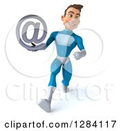 Clipart Of A 3d Young Brunette White Male Super Hero In A Blue Suit Walking And Holding An Email Arobase At Symbol Royalty Free Vector Illustration by Julos