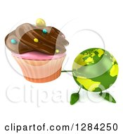 Clipart Of A 3d Green Earth Character Holding Up A Chocolate Frosted Cupcake Royalty Free Illustration