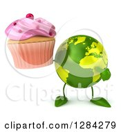 Clipart Of A 3d Green Earth Character Holding And Pointing To A Pink Frosted Cupcake Royalty Free Illustration
