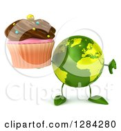 Clipart Of A 3d Green Earth Character Holding A Thumb Down And A Chocolate Frosted Cupcake Royalty Free Illustration