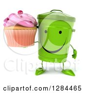 Clipart Of A 3d Happy Recycle Bin Character Holding A Pink Frosted Cupcake Royalty Free Illustration