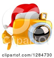 Clipart Of A 3d Christmas Yellow Camera Character Wearing A Santa Hat And Holding A Thumb Down Royalty Free Illustration