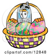 Wireless Cellular Telephone Mascot Cartoon Character In An Easter Basket Full Of Decorated Easter Eggs