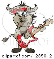 Clipart Of A Cartoon Happy Wildebeest Playing An Electric Guitar Royalty Free Vector Illustration by Dennis Holmes Designs