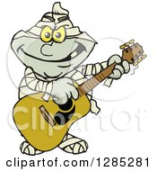 Cartoon Mummy Playing An Acoustic Guitar