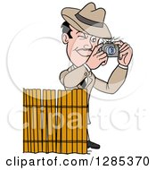 Clipart Of A Cartoon Caucasian Male Detective Taking Pictures Behind A Screen Royalty Free Vector Illustration