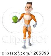 Clipart Of A 3d Young Brunette White Male Super Hero In An Orange Suit Walking And Holding A Green Bell Pepper Royalty Free Illustration