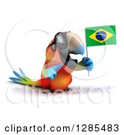 Clipart Of A 3d Scarlet Macaw Parrot Wearing Sunglasses Facing Slightly Right Holding And Pointing To A Brazil Flag Royalty Free Illustration