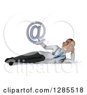 3d Young Black Male Doctor Resting On His Side And Holding An Email Arobase At Symbol