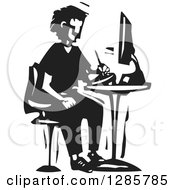 Clipart Of A Black And White Woodcut Man Drawing On A Tablet At A Computer Desk Royalty Free Vector Illustration