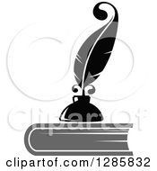 Clipart Of A Grayscale Feather Quill Pen And Ink Well On Top Of A Book Royalty Free Vector Illustration