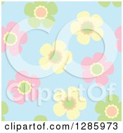 Seamless Background Pattern Of Colorful Pastel Flowers On Blue