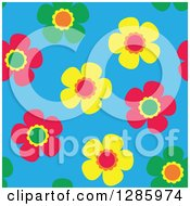 Seamless Background Pattern Of Green Yellow And Pink Flowers On Blue