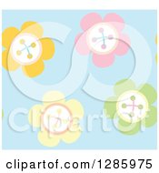 Seamless Background Pattern Of Pastel Colorful Sewn Flowers On Blue