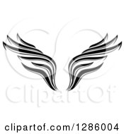 Clipart Of A Black And White Wing Tattoo Design Royalty Free Vector Illustration by Cherie Reve