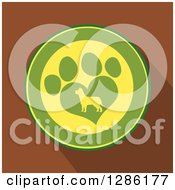 Clipart Of A Modern Flat Design Of A Green And Yellow Circle Of A Silhouetted Dog In A Heart Shaped Paw Print Over Brown With Shadows Royalty Free Vector Illustration by Hit Toon