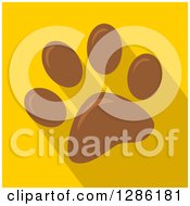 Clipart Of A Modern Flat Design Of A Brown Pet Paw Print And Shadows On Yellow Royalty Free Vector Illustration