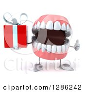 3d Mouth Teeth Mascot Holding A Gift And Thumb Up