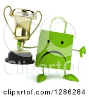 Clipart Of A 3d Unhappy Green Shopping Or Gift Bag Character Holding A Trophy And Thumb Down Royalty Free Illustration